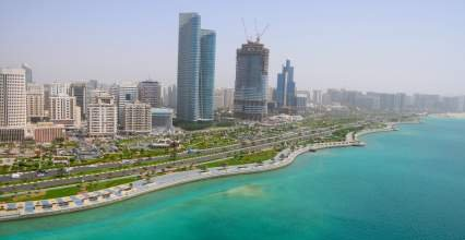 Hydrogen Power Abu Dhabi With View Of Abu Dhabi Corniche - iStockPhoto