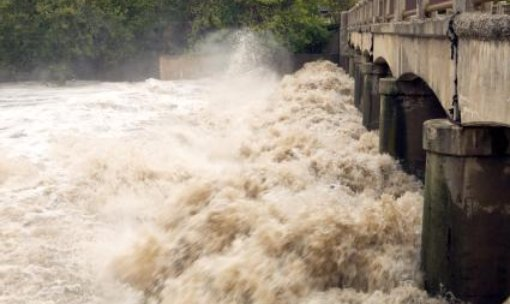 River in flood carrying vast quantities of silt - iStockPhoto