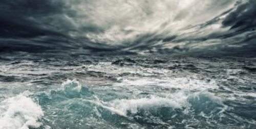 Wind circling over ocean surface creating surface disturbances - iStockPhoto