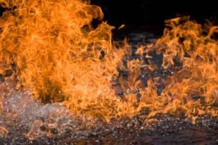 Greenhouse Gases Spontaneous Methane Burning On Water - iStockPhoto