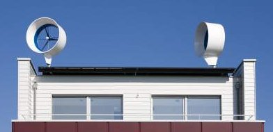 Residential Wind Turbine Pair Above Netherlands Rooftop - iStockPhoto