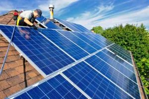 Home Solar Power Panels Being Installed On A Roof - iStockPhoto
