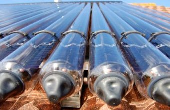 Solar Thermal Energy Utilised By Roof Collecting Tubes - iStockPhoto