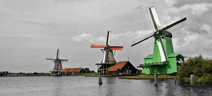 Dutch Windmills on canal - iStockPhoto