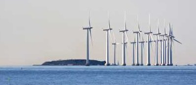 Offshore Wind Farm Near Island - iStockPhoto