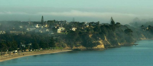 Early morning haze over Eastern Beach, Auckland, New Zealand which limits regular solar thermal collection