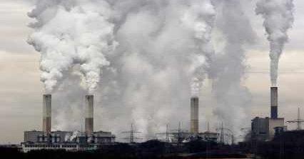 Global Warming News And Contributing Smokestacks - iStockPhoto
