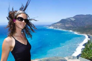 Offshore Wind Idea Shown In Onshore Wind In Girls Hair -iStockPhoto