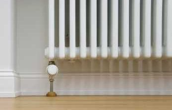 Geothermal Energy Piped Hot Water Through Radiators - iStockPhoto