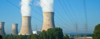 Three Mile Island With Damaged Cooling Towers In Background - iStockPhoto