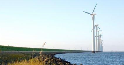 Wind Turbines Sited on Dutch Polder - iStockPhoto