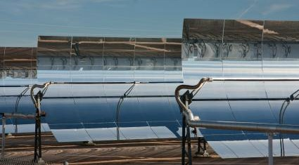 Solar Thermal Power Plant Parabolic Mirrors concentrating heat in the central collecting tubes